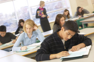 photo of teens taking a test in a classroom