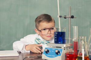 color photo of a fourth-grade boy doing a science project