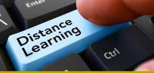 color photo of a computer key saying ''distance learning''